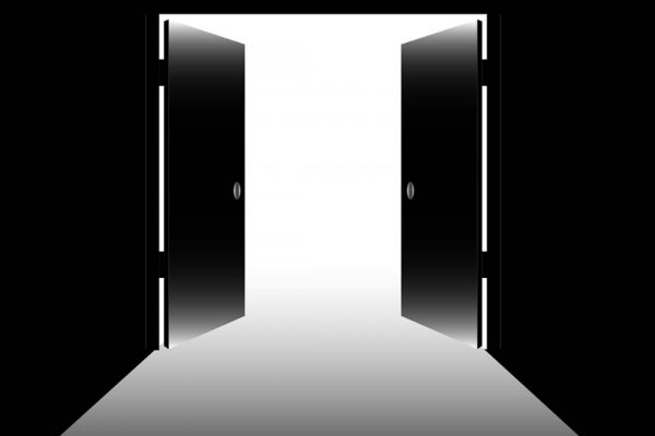 Black doors leading into an open white space